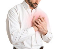 Man in Pain. Man having a pain in the heart area, isolated in white, red circle around painful area Royalty Free Stock Image