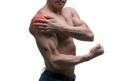 Man with pain in shoulder, ache in muscular male body, isolated on white background. With red dot Royalty Free Stock Photo