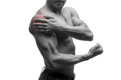 Man with pain in shoulder, ache in muscular male body, isolated on white background with red dot. Black and white photo Royalty Free Stock Photo