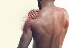 Man with pain in shoulder. Concept of human pain royalty free stock photography