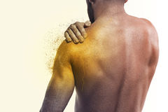 Man with pain in shoulder. Concept of human pain stock images