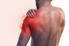 Man with pain in shoulder Stock Image
