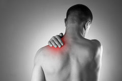 Man with pain in shoulder. Pain in the human body Royalty Free Stock Photography