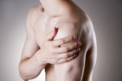Man with pain in shoulder. Pain in the human body Stock Images