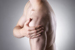 Man with pain in shoulder. Pain in the human body Royalty Free Stock Image