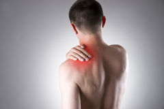 Man with pain in shoulder. Pain in the human body Stock Image
