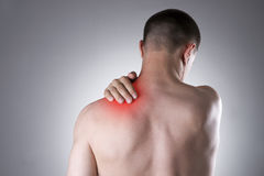 Man with pain in shoulder. Pain in the human body Royalty Free Stock Photo