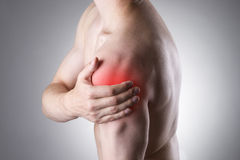 Man with pain in shoulder. Pain in the human body Stock Photos