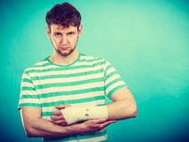 Man with painful bandaged hand. Stock Images