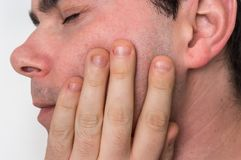 Man with a painful expression is having toothache. Body pain concept royalty free stock photos