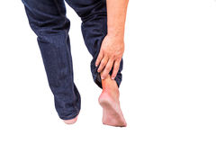 Man with painful inflammation at back of foot Royalty Free Stock Photo