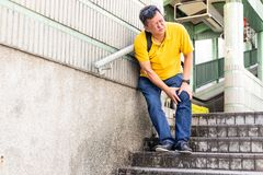 Man with painful knee struggle walking down flight of stairs royalty free stock images