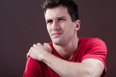 Man with a painful shoulder Royalty Free Stock Photo
