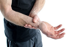 Man with painful wrist. Man holding his sore wrist stock images