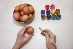 Man paint Easter egg. Man is going to paint Easter egg Stock Photo