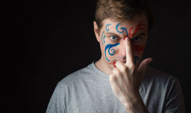 Man with paint on his face. Stock Photo