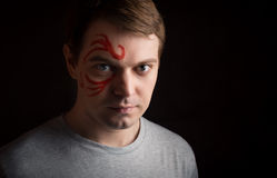 Man with paint on his face. Royalty Free Stock Image