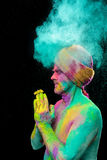 Man in paint holi. Senior man in traditional Indian turban fully covered with paint holi Royalty Free Stock Image