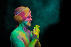 Man in paint holi. Senior man in traditional Indian turban fully covered with paint holi Royalty Free Stock Photos