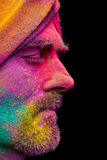 Man in paint holi. Senior man in traditional Indian turban fully covered with paint holi Stock Images