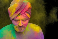 Man in paint holi. Senior man in traditional Indian turban fully covered with paint holi Stock Photo