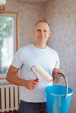Man with paint roller Stock Image