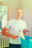 Man with paint roller Royalty Free Stock Photos