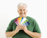 Man with paint swatches. Royalty Free Stock Photo