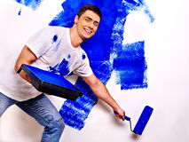 Man paint wall at home. Stock Images