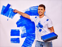 Man paint wall at home Royalty Free Stock Photos
