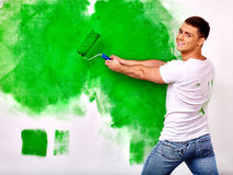 Man paint wall at home Royalty Free Stock Image