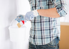 Man with paintbrush and pot Stock Image