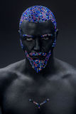 Man painted in black color with rhinestones stock photo
