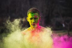 Man Painted With Green and Purple Paints Photo Stock Images