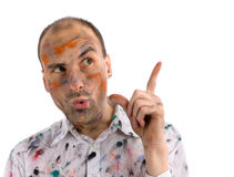 Man with painted hands and face. Funny and some mad young man with painted hands and face Stock Photos