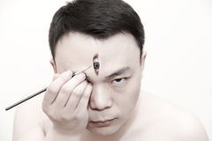 Man painted artificial eye Stock Photo