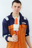 Man painter is holding paint brush and color tube Stock Image