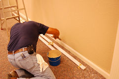 Man painting. Time to get the ole paint-brush out again stock photos