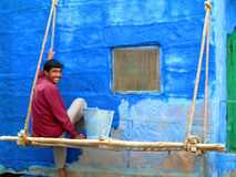 Man painting. JODHPUR - OCTOBER 29. Indian man painting his house in blue on October 29, 2004 in Jodhpur, India. Jodhpur is famously known as the blue city Stock Photos