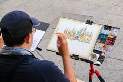 Man painting Basilica of Saint Mark at Piazza San Marco in Venice, Italy. Venice is one of the most important tourist destinations in the world for its royalty free stock photos