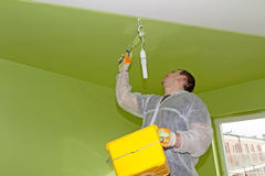 Man painting a ceiling Royalty Free Stock Images