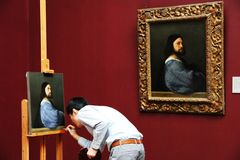 Man is painting in a museum stock images
