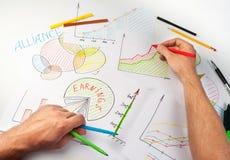 Man painting diagrams Stock Photos