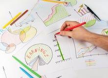 Man painting diagrams Royalty Free Stock Photos
