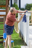 Man painting fence Stock Photos