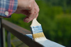 Man painting a guardrail Stock Image