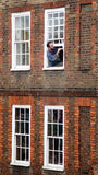 Man painting his window frame Stock Photos