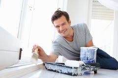 Man painting house. Smiling at camera Stock Photos
