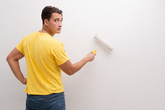 The man painting house in diy concept. Man painting house in DIY concept Royalty Free Stock Image