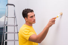 The man painting house in diy concept. Man painting house in DIY concept Stock Photography